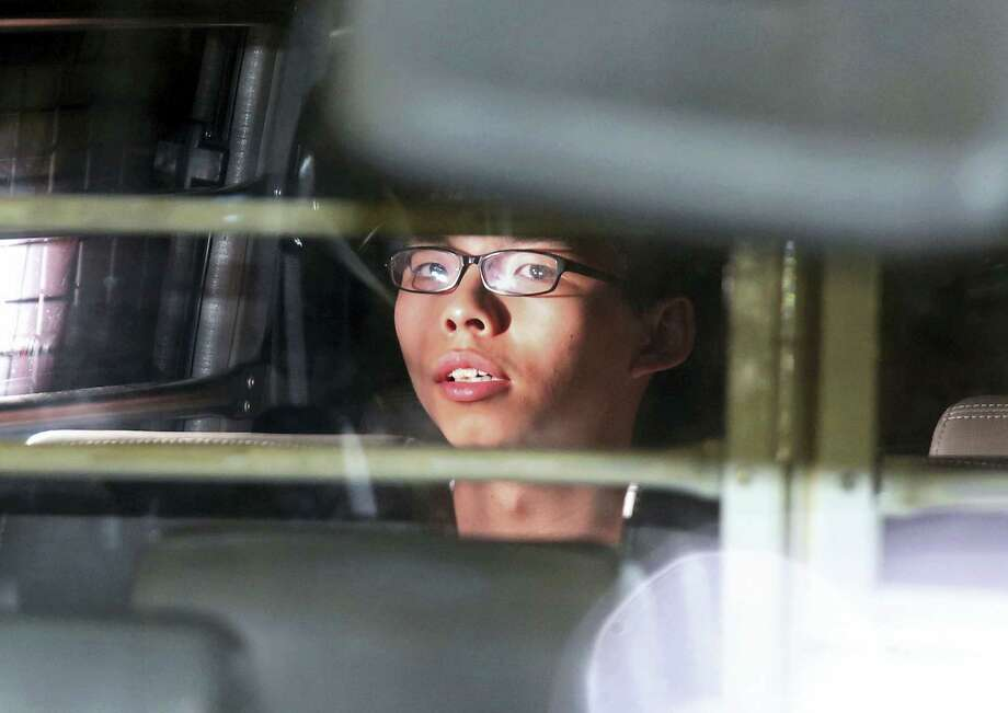 Hong Kong activist Joshua Wong is taken away in a prison bus leaving the high court after his sentencing in Hong Kong, Thursday, Aug. 17, 2017. The court Thursday overturned sentences that the prosecution said were too light and sent Wong and two other student leaders of huge pro-democracy protests in 2014 to prison. Photo: AP Photo   / Copyright 2017 The Associated Press. All rights reserved.