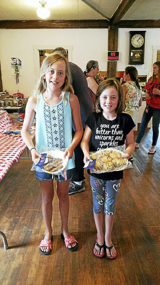 Junior Grange members Molly Keefe, 10, and her sister Addie Keefe, 8, of Barkhamsted displayed their respective first-prize-winning molasses cookies and blueberry muffins at the 28th annual Riverton Grange Fair at the Riverton Grange Hall at 9 Riverton Road in Riverton on Saturday afternoon. Photo: Nf Ambery