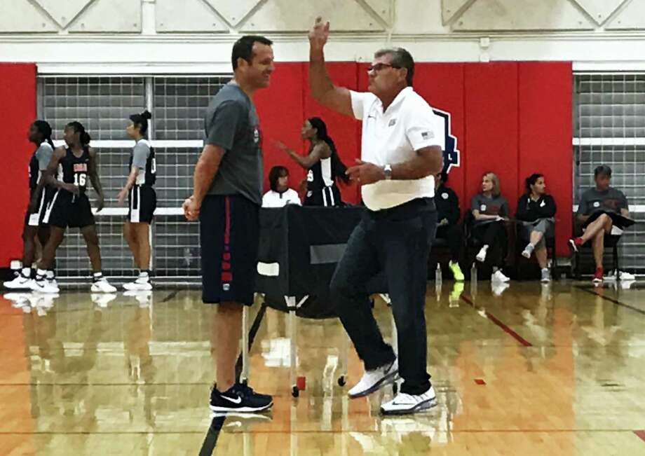 UConn head coach Geno Auriemma, right, and Louisville head coach Jeff Walz talk during the US Under-23 training camp in Colorado Springs, Colo. on Monday. Photo: AP Photo – Doug Feinberg  / AP