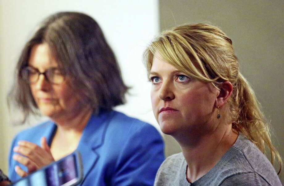 Nurse Alex Wubbels, right, looks on during an interview while her attorney Karra Porter looks on, Friday, Sept. 1, 2017, in Salt Lake City. Wubbels followed hospital policy and advice from her bosses when she told Salt Lake City police Detective Jeff Payne that he could not get a blood sample without a warrant or consent from the patient, according to Porter. The police department is making changes after Payne dragged a screaming Wubbels out of the hospital in handcuffs when she refused to allow blood to be drawn from the unconscious patient. Photo: Rick Bowmer / AP Photo  / Copyright 2017 The Associated Press. All rights reserved.