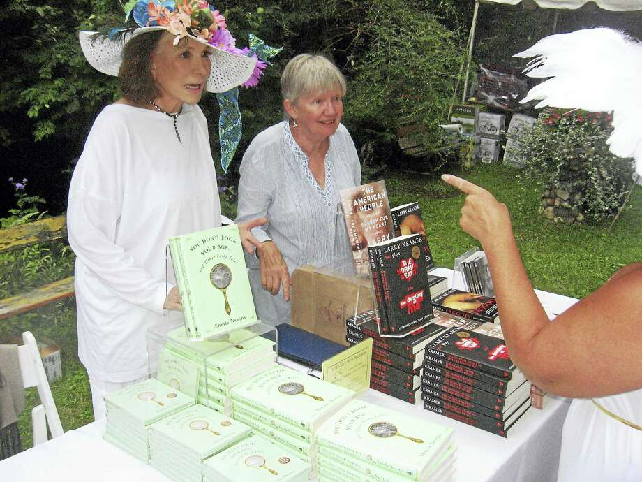 Author Sheila Nevins, left, signs books for her fans at the Tea for Two Hundred event. Photo: John Torsiello Photo