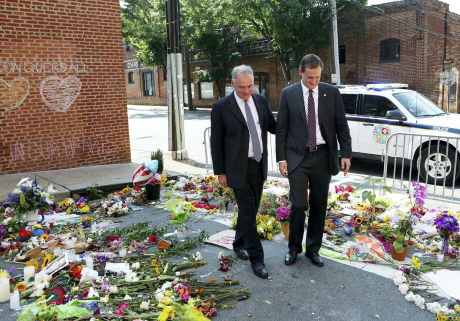 Sen. Tim Kaine, left, and Charlottesville mayor Michael Signer visit a makeshift memorial Wednesday, Aug. 16, 2017, where Heather Heyer was killed when a car rammed into a crowd of people protesting a white nationalist rally Charlottesville, Va. Photo: Julia Rendleman / AP Photo  / Julia Rendleman