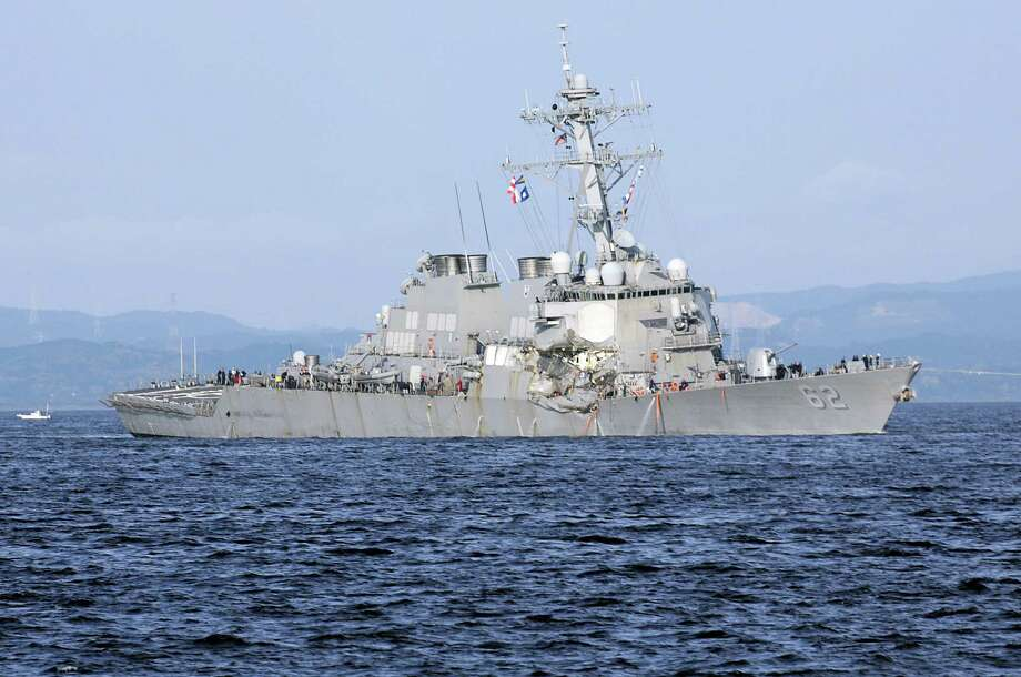 This June 17, 2017 file photo shows the damaged USS Fitzgerald near the U.S. Naval base in Yokosuka, southwest of Tokyo. The Navy says the commanding officer of a warship that lost seven sailors in a collision off the coast of Japan will be relieved of command, and nearly a dozen other sailors face punishment. Adm. William Moran, the No. 2 Navy officer, told reporters at the Pentagon on Thursday, Aug. 17, that the actions are to be taken shortly, although the Navy's investigation into how and why the USS Fitzgerald collided with the container ship in June has not yet been completed. Photo: AP Photo/Eugene Hoshiko, File  / Copyright 2017 The Associated Press. All rights reserved.