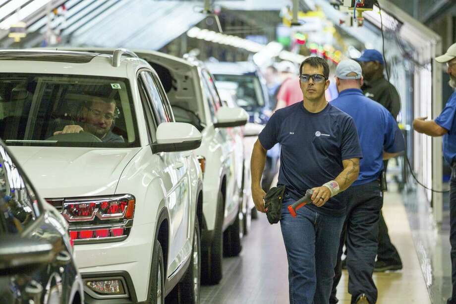 Workers produce vehicles at Volkswagen's lone U.S. plant in Chattanooga, Tenn. The plant has begun production of the midsized Atlas SUV alongside the Passat sedan. Photo: Erik Schelzig / The Associated Press  / Copyright 2017 The Associated Press. All rights reserved.