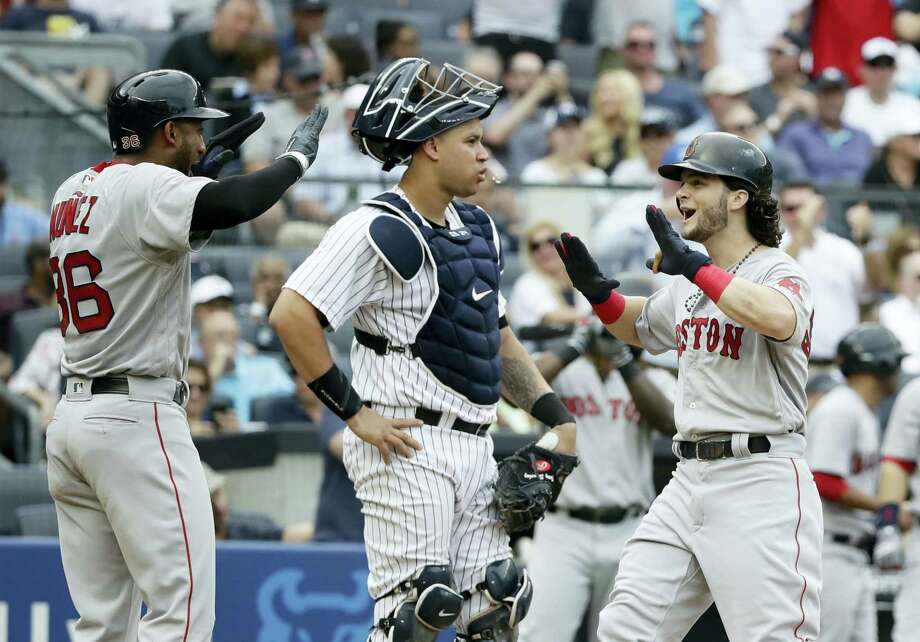 Andrew Benintendi, right, celebrates with Eduardo Nunez (36) after hitting a three-run home run in the fifth inning Saturday in New York. Photo: Frank Franklin II — The Associated Press  / Copyright 2017 The Associated Press. All rights reserved.