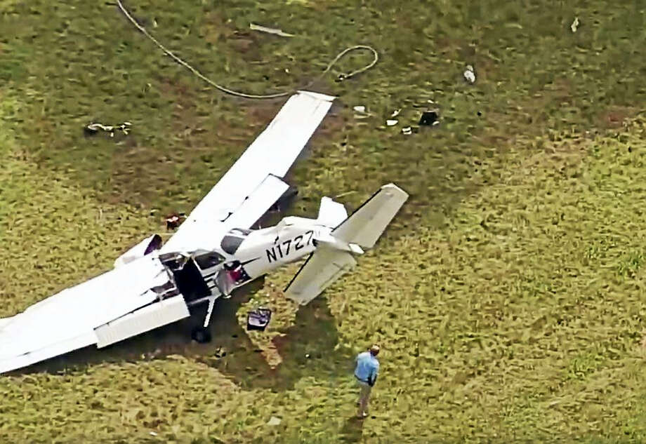 A man is dead and two people are injured after a plane from Danbury Municipal Airport crashed at Candlelight Farms Airport in New Milford on Friday. Photo: Contributed / NBC Connecticut  / The News-Times Contributed