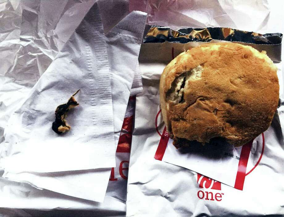 This Nov. 25, 2016, photo provided by Ellen Manfalouti, of Holland, Pa., shows the remains of a rodent, left, she alleges she found baked into the bun of a chicken sandwich, right, that a co-worker purchased for her that day at a Chick-fil-A franchise restaurant in Langhorne, Pa. Manfalouti, a suburban Philadelphia woman, sued in Bucks County Court in August 2017 over the rodent she claims was baked into the bottom bun of her chicken sandwich. Photo: Ellen Manfalouti Via AP   / Ellen Manfalouti