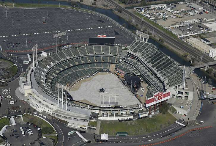 """This Feb. 5, 2016 file photo shows the Oakland Coliseum in Oakland, Calif. The Oakland Athletics have picked land near Oakland's Lake Merritt as the site for an intimate new ballpark, Wednesday, Sept. 13, 2017. Team President Dave Kaval says in a letter to the Peralta Community College District that he believes the location presents an opportunity to keep the city's """"last professional sports team in Oakland for the long term."""" (AP Photo/Eric Risberg, File)"""