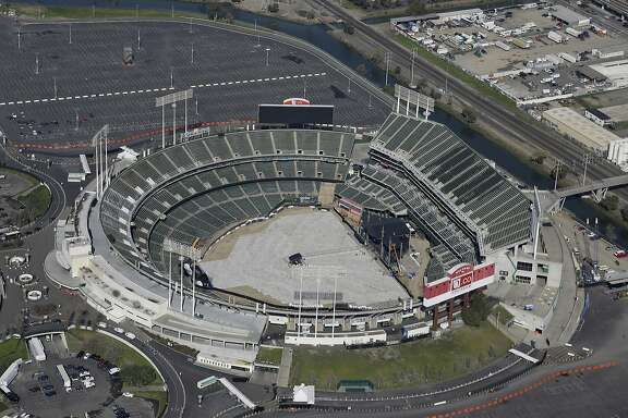"This Feb. 5, 2016 file photo shows the Oakland Coliseum in Oakland, Calif. The Oakland Athletics have picked land near Oakland's Lake Merritt as the site for an intimate new ballpark, Wednesday, Sept. 13, 2017. Team President Dave Kaval says in a letter to the Peralta Community College District that he believes the location presents an opportunity to keep the city's ""last professional sports team in Oakland for the long term."" (AP Photo/Eric Risberg, File)"
