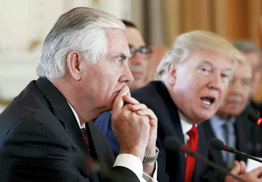 In this April 7, 2017, file photo Secretary of State Rex Tillerson, left, listens as President Donald Trump speaks during a bilateral meeting with Chinese President Xi Jinping at Mar-a-Lago in Palm Beach, Fla. Tillerson hasn't always seen eye-to-eye with his boss. But Trump's top diplomat he says he's comfortable in his job and in his relationship with the commander in chief. Speaking to reporters at a nearly hour-long news conference at the State Department on Aug. 1, Tillerson sought to dispel speculation that he is frustrated and looking for a way out. Photo: Alex Brandon / AP Photo, File  / Copyright 2017 The Associated Press. All rights reserved.
