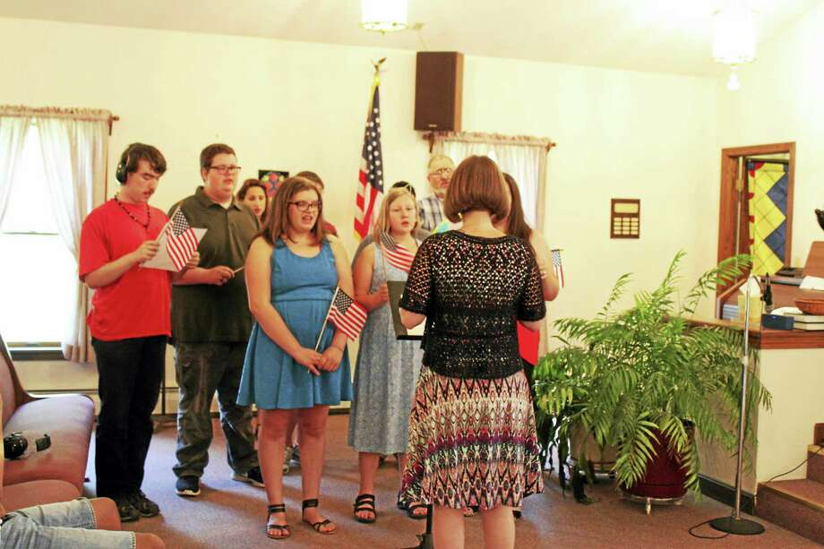 Students at the Fresh Start School for adolescents affected by autism sing the National Anthem at the June 21 ceremony held at the Canton Community Baptist Church honoring the first graduating class. Photo: Contributed Photo