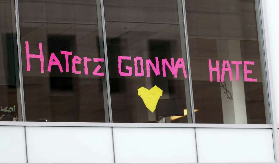 Borrowing a line from one of her songs, workers put up a sign in support of pop singer Taylor Swift in the window of an office building across the street from the federal courthouse Wednesday, Aug. 9, 2017, in Denver. Former DJ David Mueller sued Swift after she said he touched her backside before a concert in Denver in 2013. He's seeking at least $3 million. Swift countersued for sexual assault and is seeking $1. Photo: AP Photo/David Zalubowski   / Copyright 2017 The Associated Press. All rights reserved.