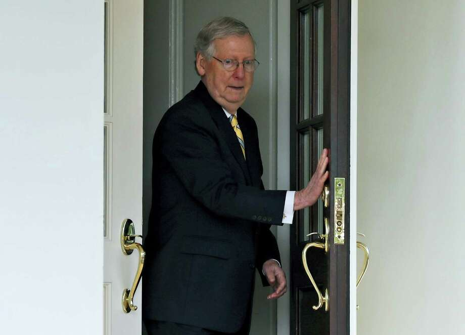 In this June 27, 2017 file photo, Senate Majority Leader Mitch McConnell of Ky. steps out of the West Wing of the White House in Washington to speak with the media after he and other Senate Republicans met with President Donald Trump. President Donald Trump raised the possibility Thursday, Aug. 10, 2017, that McConnell should step down if he can't muscle health care and other legislation through the Senate, taking an extraordinary swipe at the man with the most power to steer the White House agenda through the chamber. Photo: Alex Brandon / AP Photo  / Copyright 2017 The Associated Press. All rights reserved.