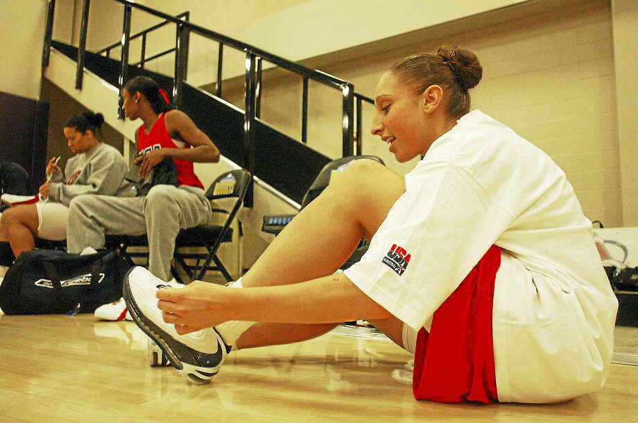 Diana Taurasi laces up her shoes as she prepares to practice with the USA Basketball women's senior national team in 2004. Photo: The Associated Press File Photo  / AP