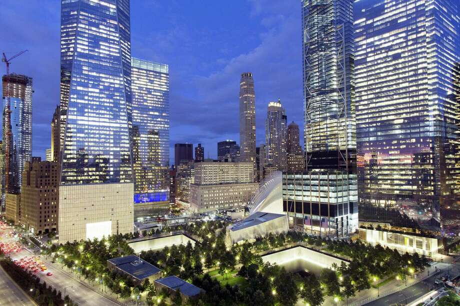 In this Sept. 8, 2017 photo, the National September 11 Memorial and Museum, bottom, is surrounded by high-rise towers in New York. The new towers are: WTC 1, second from left, WTC 7, third from left, WTC 3, second from right, and WTC 4, right. Monday will mark the sixteenth anniversary of the terrorist attacks. Photo: AP Photo — Mark Lennihan  / Copyright 2017 The Associated Press. All rights reserved.