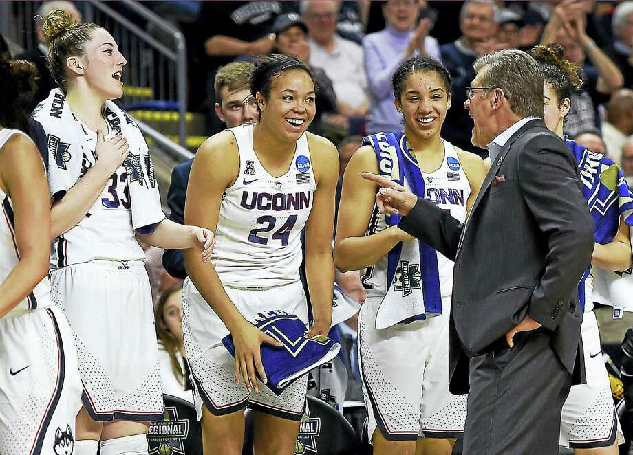 Connecticut head coach Geno Auriemma, right, jokes with Katie Lou Samuelson, left, Napheesa Collier, second from left, and Gabby Williams as the clock winds down on their 90-52 win over Oregon in a regional final game in the NCAA women's college basketball tournament, Monday, March 27, 2017, in Bridgeport, Conn. (AP Photo/Jessica Hill) Photo: AP / AP2017