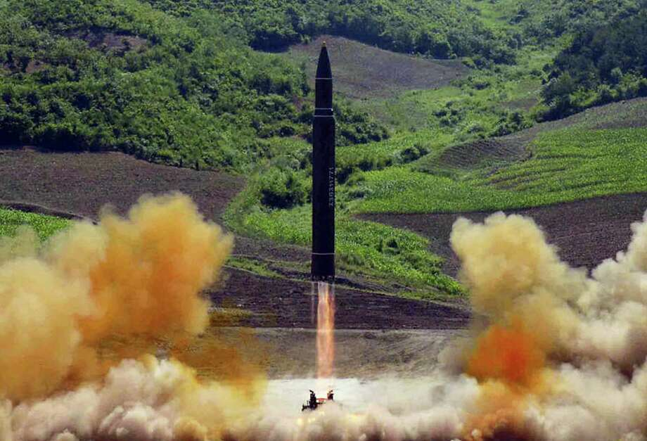 """This file photo distributed by the North Korean government shows what was said to be the launch of a Hwasong-14 intercontinental ballistic missile, ICBM, in North Korea's northwest, Tuesday, July 4, 2017. Donald Trump's threat to unleash """"fire and fury"""" on North Korea might have been written by Pyongyang's propaganda mavens, so perfectly does it fit the North's cherished claim that it is a victim of American aggression. Photo: Korean Central News Agency/Korea News Service Via AP, File   / KCNA via KNS"""