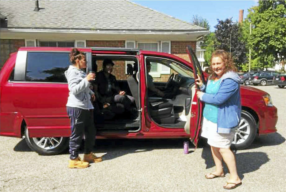 Members of Prime Time House get ready for a ride in the new mini-van, purchased with a matching grant from the Seherr-Thoss Foundation. Photo: Contributed Photo