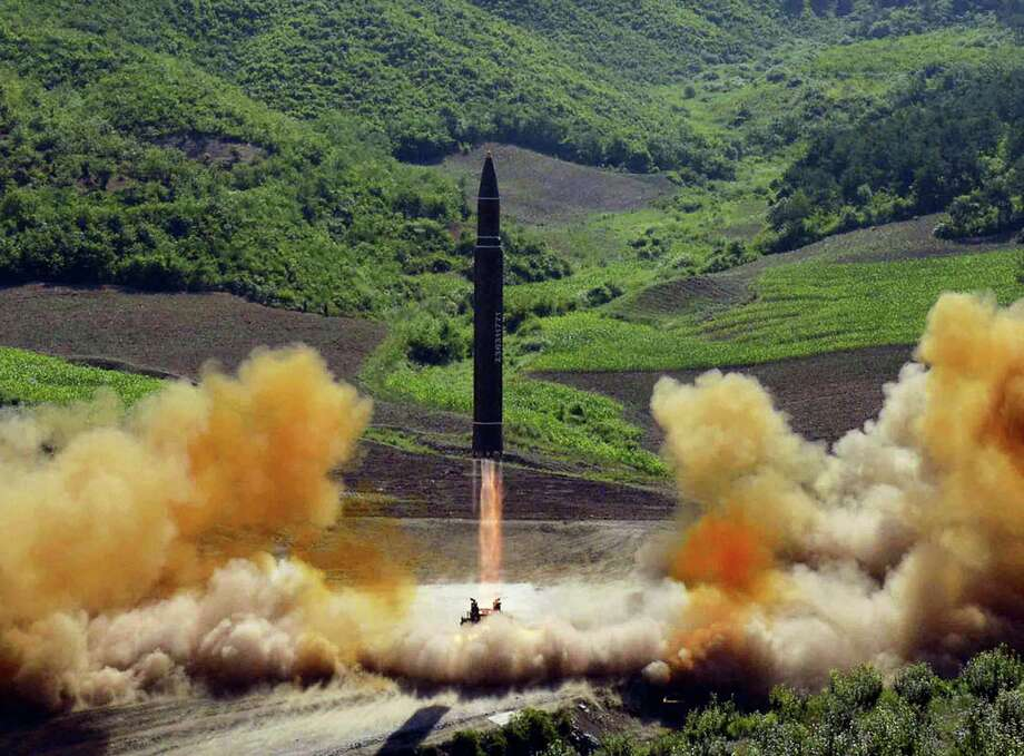 This file photo distributed by the North Korean government shows what was said to be the launch of a Hwasong-14 intercontinental ballistic missile, ICBM, in North Korea's northwest, Tuesday, July 4, 2017. Independent journalists were not given access to cover the event depicted in this photo. The strongest U.N. sanctions in a generation may still prove no match for North Korea's relentless nuclear weapons ambitions. Even in diplomatic triumph, the Trump administration is gambling that it has enough time to test if economic pressure can get Kim Jong Un's totalitarian government to end its missile advances and atomic weapons tests. Photo: Korean Central News Agency/Korea News Service Via AP, File   / KCNA via KNS