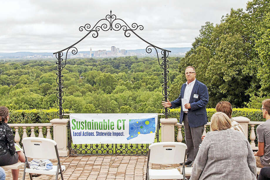 Contributed photo Ted Shafer, First Selectman for the Town of Burlington and Chair of the Sustainable CT Advisory Committee, addresses partners and collaborators during a recent celebration. Photo: Digital First Media