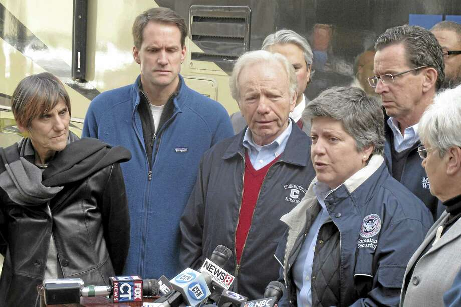 Dave Collins / associated press  U.S. Homeland Security Secretary Janet Napolitano, right, speaks at a news conference in Bridgeport after touring storm-damaged areas with Connecticut officials. From left to right are U.S. Rep. Rosa DeLauro, U.S. Rep. Jim Himes, U.S. Sen. Joe Lieberman, Napolitano, Connecticut Gov. Dannel P. Malloy and Lt. Gov. Nancy Wyman. Photo: AP / 2012 AP