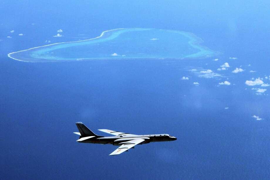 A Chinese H-6K bomber patrols the islands and reefs in the South China Sea. Photo: Liu Rui/Xinhua Viaassociated Press / Xinhua News Agency