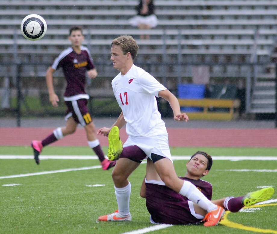 Greenwich's Lucas Jordao 917) and St. Joseph's Michael Pleszko battle for the ball iduring their FCIAC game Tuesday afternoon at Greenwich High School. The Cardinals won 5-0. Photo: Matthew Brown / Hearst Connecticut Media / Stamford Advocate