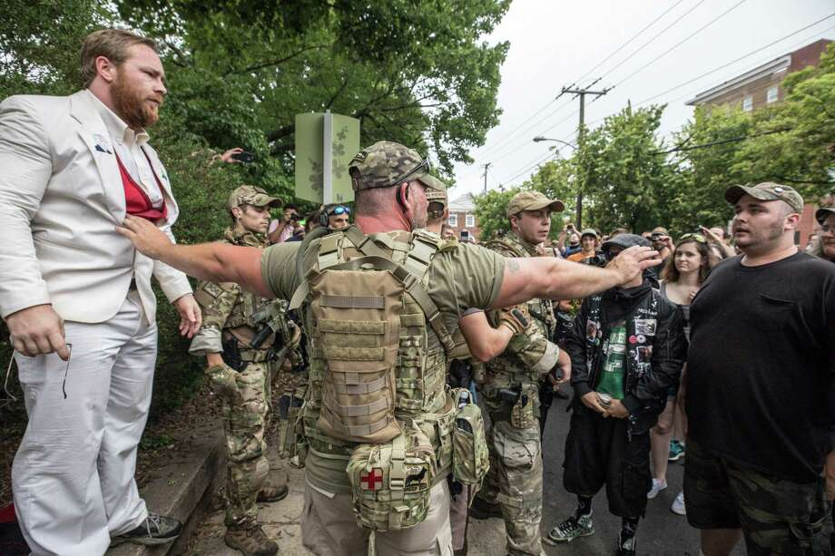 """A member of """"The Militia"""" keeps the peace outside the Unite the Right rally on Saturday in Charlottesville, Va. Photo: Evelyn Hockstein / The Washington Post / Evelyn Hockstein"""