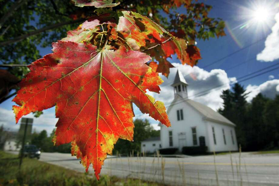 In this file photo, a maple tree shows its fall colors in Woodstock, Maine. New England's 2017 fall foliage forecast is very favorable for leaf peeping. Photo: Robert F. Bukaty — The Associated Press File  / 2010 AP