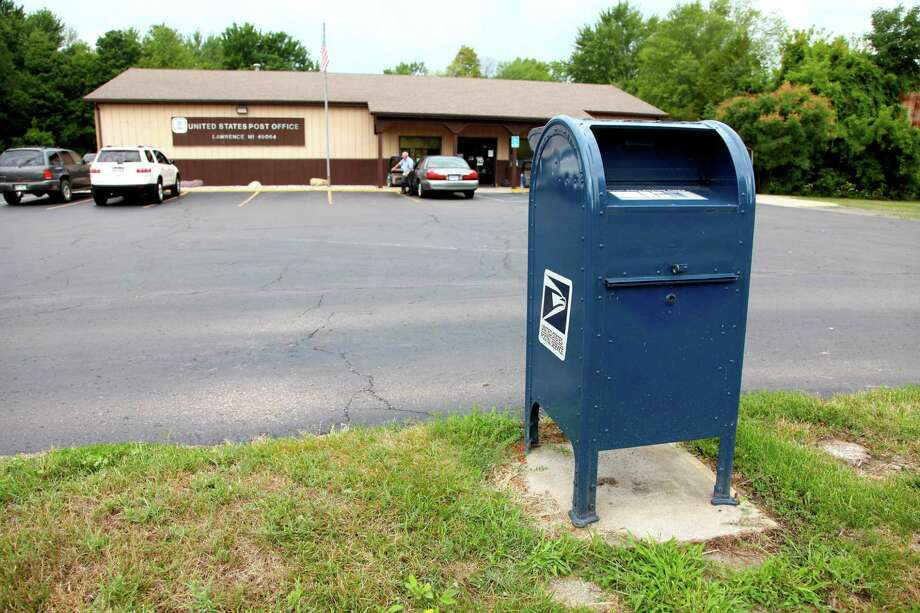 A mailbox outside a U.S. Post Office in Lawrence, Mich. Photo: The Associated Press  / AP