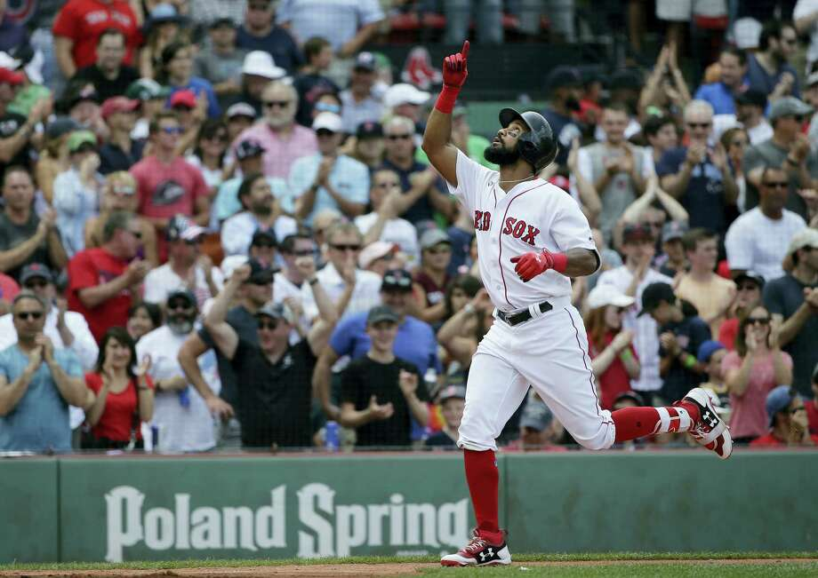 Chris Young celebrates as he arrives at home plate after hitting a three-run home run in the fifth inning Sunday in Boston. Photo: Steven Senne — The Associated Press  / Copyright 2017 The Associated Press. All rights reserved.