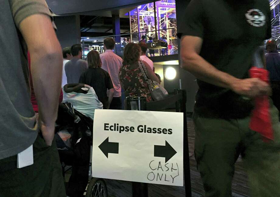 Utah residents flock to the planetarium in Salt Lake City, Wednesday to buy eclipse glasses to make sure they get ones that aren't faulty following a recall issued by online retailer Amazon. The Clark Planetarium has seen a huge spike in sales this week of the facility's $2 glasses after the John A. Moran Eye Center at the University of Utah on Sunday, Aug. 13, told people to throw out the glasses the centre gave away this month because of the recall, said Rob Morris, director of operations. People could keep ones with a Clark Planetarium label, the center said. Photo: AP Photo/Brady McCombs / Copyright 2017 The Associated Press. All rights reserved.