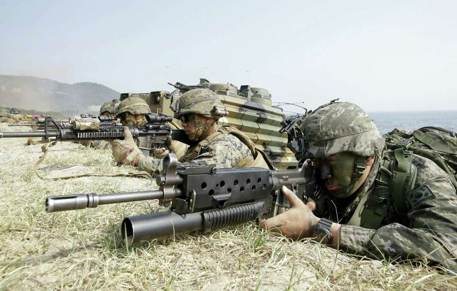 """In this March 30, 2015, file photo, Marines of South Korea, right and the U.S aim their weapons near amphibious assault vehicles during the U.S.-South Korea joint landing military exercises as a part of the annual joint military exercise Foal Eagle between South Korea and the United States in Pohang, South Korea. America's annual joint military exercises with South Korea always frustrate North Korea. The war games set to begin Monday, Aug. 21, 2017 may hold more potential to provoke than ever, given President Donald Trump's """"fire and fury"""" threats and Pyongyang's as-yet-unpursued plan to launch missiles close to Guam. Photo: AP Photo/Lee Jin-man, File  / Copyright 2017 The Associated Press. All rights reserved."""