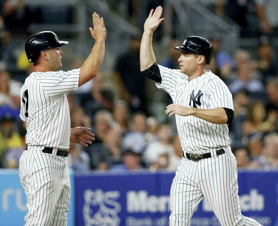 New York Yankees designated hitter Matt Holliday, left, greets Chase Headley after they scored on Todd Frazier's two-run single during the fourth inning of a baseball game against the Detroit Tigers at Yankee Stadium in New York on July 31, 2017. Photo: AP Photo — Kathy Willens  / Copyright 2017 The Associated Press. All rights reserved.