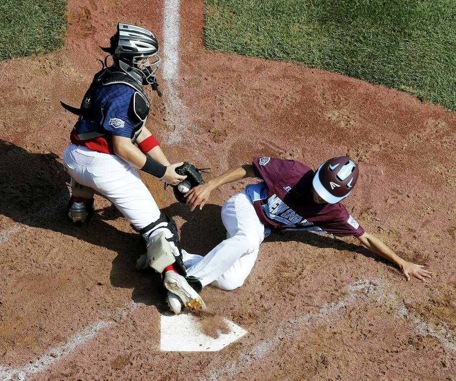 Fairfield American's Matthew Vivona, right, scores past the attempted tag by Jackson, N.J., catcher J.R. Osmond in the first inning Thursday. Photo: Gene J. Puskar — The Associated Press  / Copyright 2017 The Associated Press. All rights reserved.