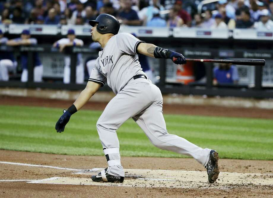 The Yankees' Gary Sanchez follows through on a three-run home run during the first inning against the Mets on Thursday in New York. Photo: Frank Franklin II — The Associated Press  / Copyright 2017 The Associated Press. All rights reserved.