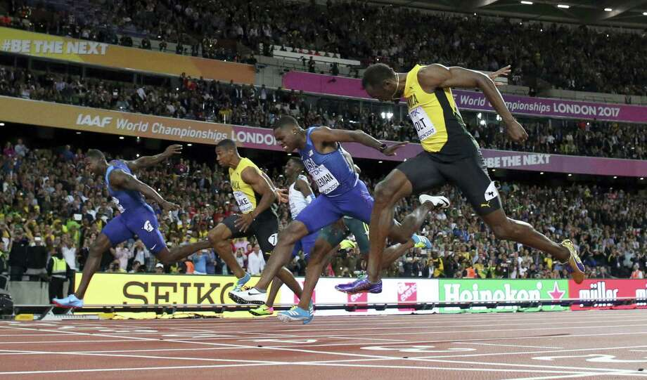 United States' Justin Gatlin, left, and Jamaica's Usain Bolt right, cross the line of the men's 100 meters final during the World Athletics Championships in London Saturday. Photo: Matthias Schrader — The Associated Press  / Copyright 2017 The Associated Press. All rights reserved.