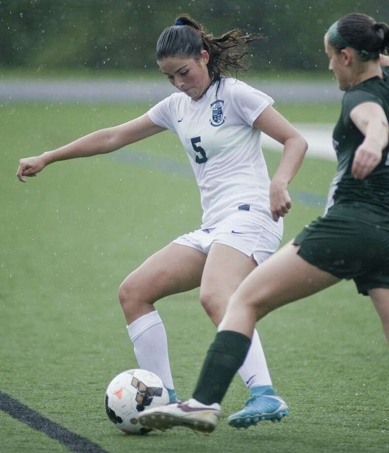 Immaculate High School's Morganne Cartee tries to get control of the ball in a game against New Milford High School, played at Immaculate. Tuesday, Sept. 19, 2017 Photo: Scott Mullin / For Hearst Connecticut Media / The News-Times Freelance
