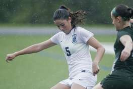 Immaculate High School's Morganne Cartee tries to get control of the ball in a game against New Milford High School, played at Immaculate. Tuesday, Sept. 19, 2017