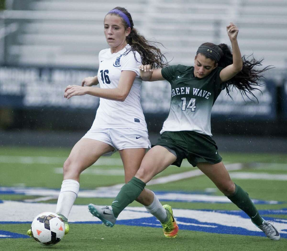 Immaculate High School's Kinsey Jarboe tries to keep the ball away from New Milford High School's Adriana Alfano in a game played at Immaculate. Tuesday, Sept. 19, 2017