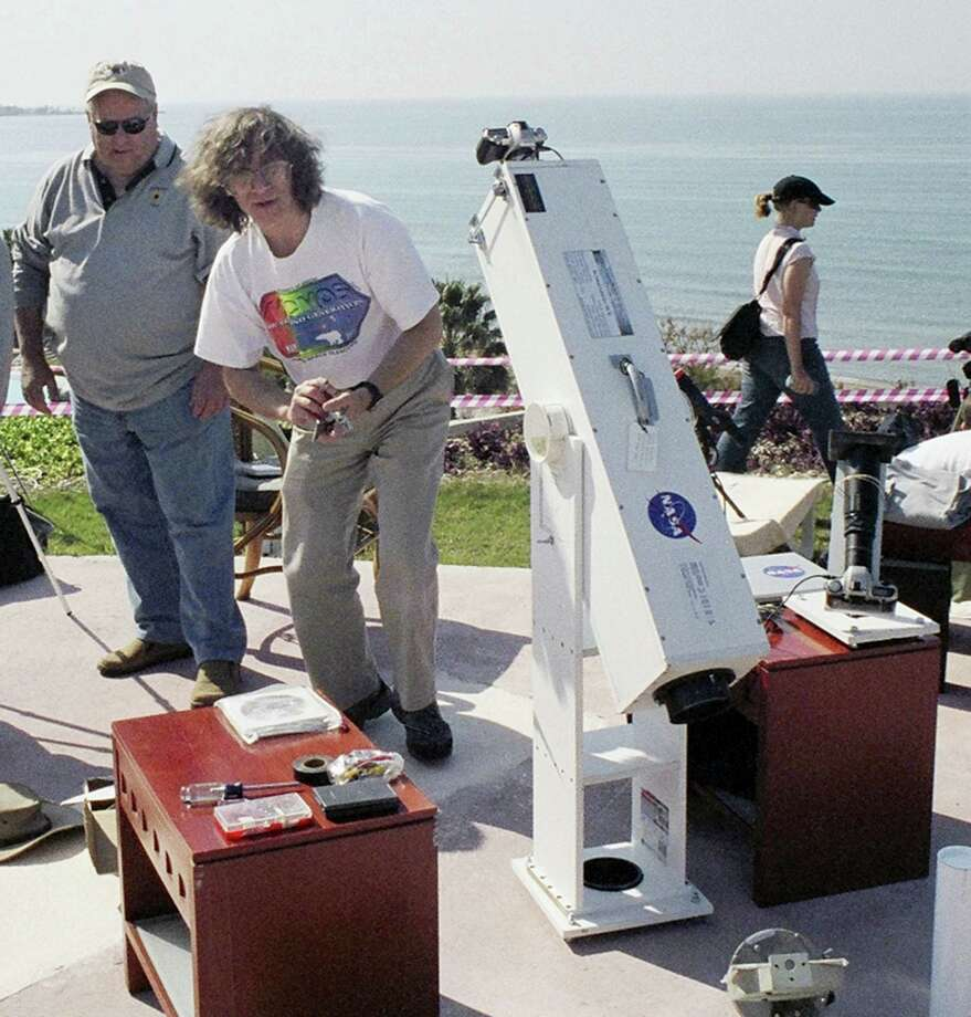 "This 2006 photo provided by Glenn Schneider shows him with his ""lug-o-scope"" in Turkey. Schneider, was 14 in 1970 when he saw his first eclipse. ""I was frozen in place,"" he recalled. ""I had binoculars around my neck for two and a half minutes and I never picked them up."" Now a University of Arizona astronomy professor, Schneider said when it was over ""I was shaking. I was crying. I was overwhelmed. It was at that instant when I said 'Yeah, this is what I'm going to do with the rest of my life'."" Photo: Courtesy Glenn Schneider Via AP  / Glenn Schneider"