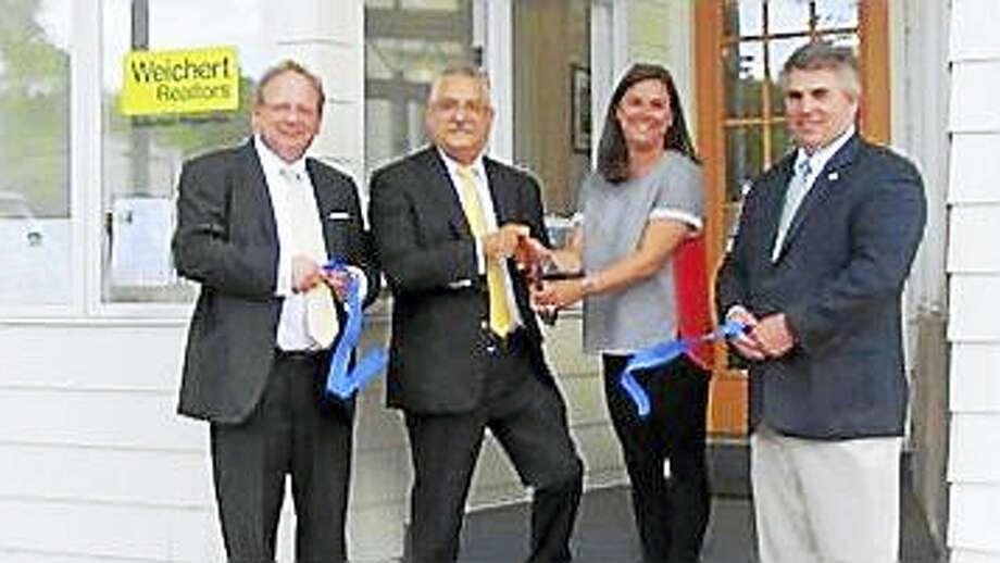 Weichert, Realtors®- Suburban Properties opened a second office in Branford. Pictured (l-r) at the grand opening are: Branford Chamber of Commerce President Ed Lazarus; Vincent Engingro and Lea DiMassa, with Weichert, Realtors®- Suburban Properties; and Branford First Selectman Jamie Cosgrove. Photo: Contributed Photo