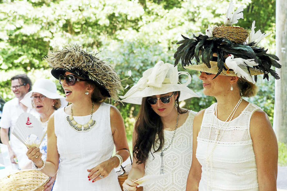Women in white with fancy hats enjoy a previous Tea for Two Hundred, which marks its 20th year on Saturday, Aug. 20. Photo: Photos By Laurie Gaboardi