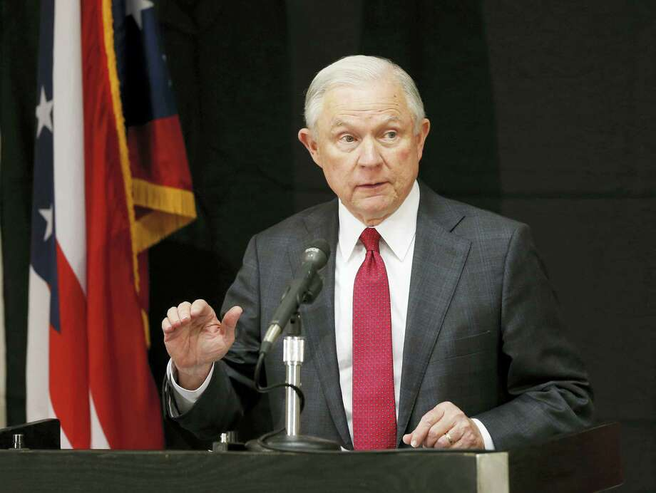 In this Aug. 2, 2017, file photo, Attorney General Jeff Sessions speaks in Columbus, Ohio. Sessions moved Thursday, Aug. 3, 2017, to again punish so-called sanctuary cities, this time threatening to deny federal crime-fighting resources to four cities beset by violence if they don'Äôt step up efforts to help detain and deport people living in the country illegally. Photo: AP Photo/Jay LaPrete, File   / FR52593 AP