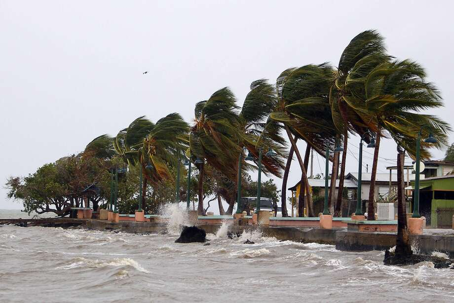 "Winds lash the coastal city of Fajardo as Hurricane Maria approaches Puerto Rico, on September 19, 2017.  Maria headed towards the Virgin Islands and Puerto Rico after battering the eastern Caribbean island of Dominica, with the US National Hurricane Center warning of a ""potentially catastrophic"" impact. / AFP PHOTO / Ricardo ARDUENGORICARDO ARDUENGO/AFP/Getty Images Photo: RICARDO ARDUENGO, AFP/Getty Images"