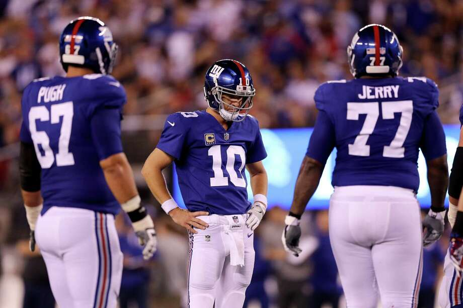 EAST RUTHERFORD, NJ - SEPTEMBER 18:  Eli Manning #10 of the New York Giants looks on in the fourth quarter against the Detroit Lions during their game at MetLife Stadium on September 18, 2017 in East Rutherford, New Jersey.  (Photo by Elsa/Getty Images) ***BESTPIX*** ORG XMIT: 700070627 Photo: Elsa / 2017 Getty Images