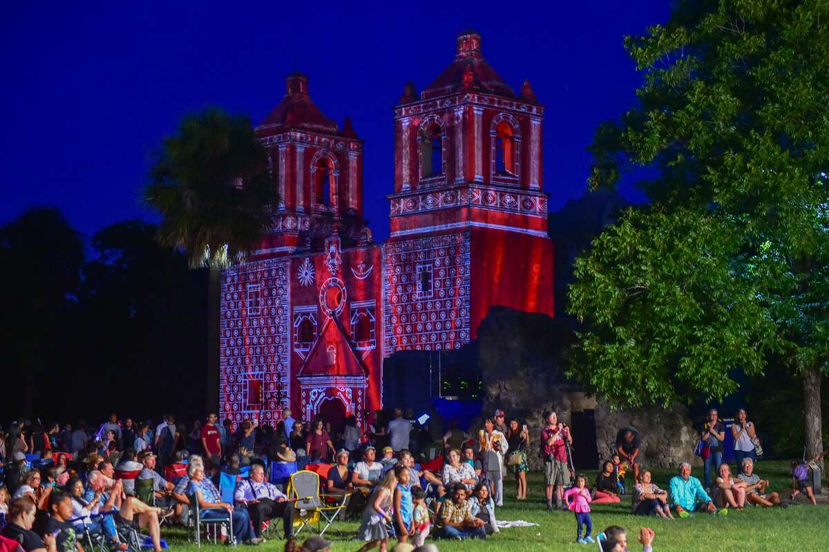 """Mission Concepcion is lit during the """"Restored by Light"""" event as over 2,000 people listen to the USAA Band and Chorus."""