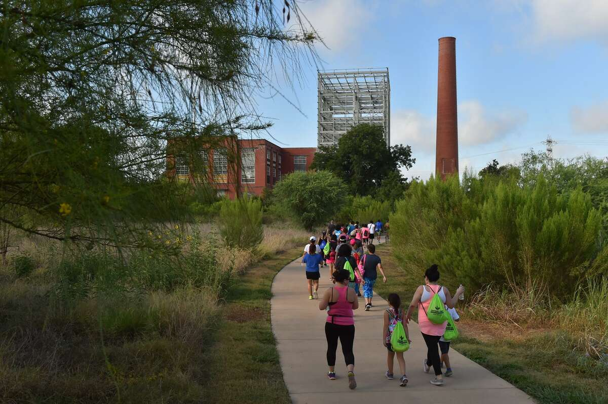 Walkers head souh along the Mission Reach from Roosevelt Park during the Fitness Walk that was part of the eighth annual Family Fitness Challenge.