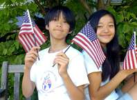 "Alain Hayashida, 14 and his sister May, 16, at Greenwich High School on Friday, June 18m 2010. Alain Hayashida, 14, from Japan: ""America is a very big place, physically.  I am afraid that when I go back to Japan it will feel very small, lots of people, and it would be a small place to live in. Here in America, you are free to do you want.  America has a great space and time. I like being in America. It feels like being free, being on your own."" May Hayashida, 16, from Japan: 'I think America is a place filled with opportunity.  In Japan, where I come from, there is not as much opportunity. The opera, for example, I was able to find a place where I could sing and act and have a lot of fun.  Here I can have the freedom to find a place where I feel comfortable singing and acting, or playing sports, or just having a lot of fun with friends. In Japan there is not a place where I would feel as comfortable.  America gives the freedom to pursue these things."" Alain Hayashida, 14, from Japan.   ""America is a very big place, physically.  I am afraid that when I go back to Japan it will feel very small, lots of people, and it would be a small place to live in. Here in America, you are free to do you want.  America has a great space and time. I like being in America. It feels like being free, being on your own.""  May Hayashida, 16, from Japan  'I think America is a place filled with opportunity.  In Japan, where I come from, there is not as much opportunity. The opera, for example, I was able to find a place where I could sing and act and have a lot of fun.  Here I can have the freedom to find a place where I feel comfortable singing and acting, or playing sports, or just having a lot of fun with friends. In Japan there is not a place where I would feel as comfortable.  America gives the freedom to pursue these things."""
