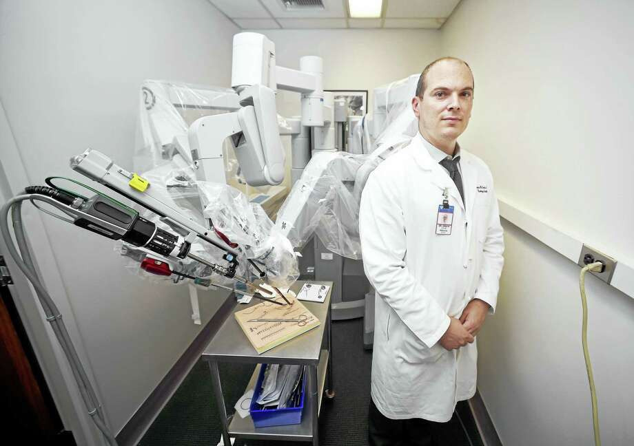 Dr. Brian Shuch, assistant professor of urology and radiology at the Yale School of Medicine, is photographed with the da Vinci Surgical System in the Surgical Simulation Lab at Yale New Haven Hospital in New Haven. Photo: Arnold Gold / Hearst Connecticut Media  / New Haven Register